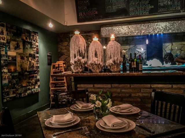 La Querencia Candles and Bar area