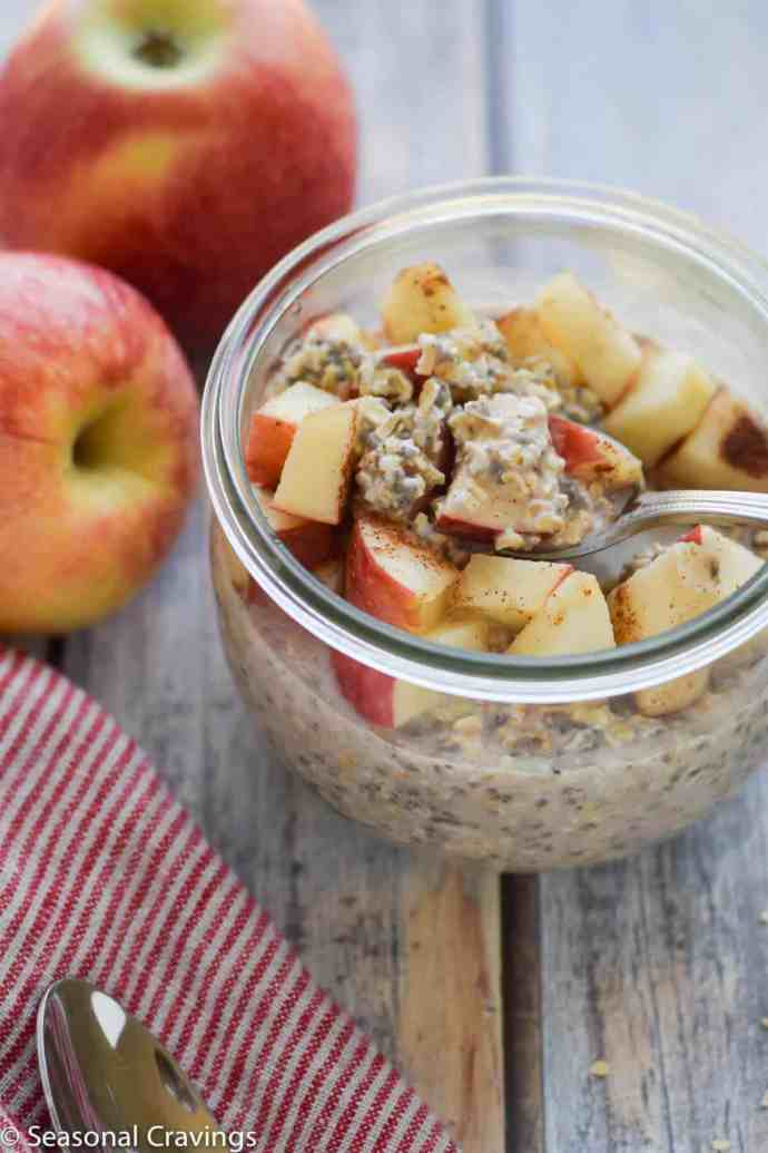 Apple Pie Overnight Oats with a spoon and apples on the side
