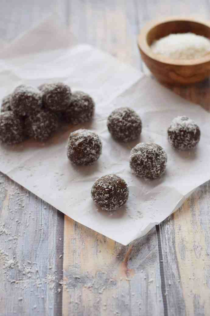 Chocolate Almond Butter Protein Balls on parchment paper