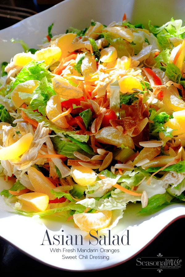 Asian Chopped Salad with fresh mandarin oranges. Easy recipe with chicken, crisp chopped vegetables, baked wonton, almonds, sweet chili dressing | seasonalmuse.com