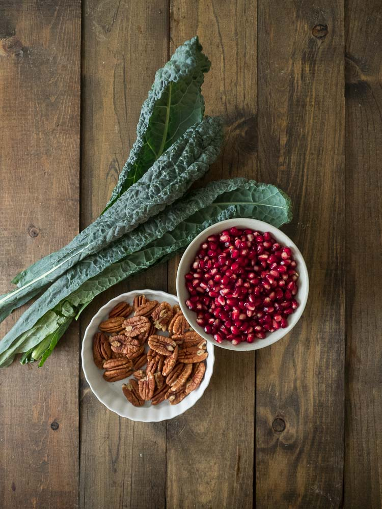 Kale Pomegranate Pecan   A beautiful kale salad with pomegranates and pecans and a simple, easy apple cider vinaigrette. The perfect side salad to your holiday meal.   seasonedvegetable.com