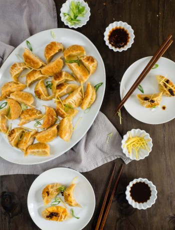 Vegetarian Dumplings with Ginger and Cabbage | These pan fried Chinese vegetarian dumplings with ginger and cabbage are paired with an easy dipping sauce recipe. The perfect way to celebrate Chinese New Year. | SeasonedVegetable.com
