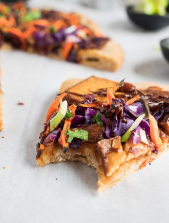 Thai Pizza | A vegan friendly pizza bursting with flavor. Easy, marinated baked tofu tops a quick peanut sauce with carrots and cabbage. | seasonedvegetable.com