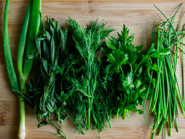 Green onion, tarragon, dill, parsley and chives for green goddess dressing.