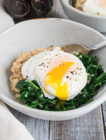 Savory Oatmeal with Wilted Arugula | A savory oatmeal breakfast with garlic wilted arugula and poached eggs is ready in less than 30 minutes. Hearty and delicious, perfect for weekdays or weekends. | SeasonedVegetable.com