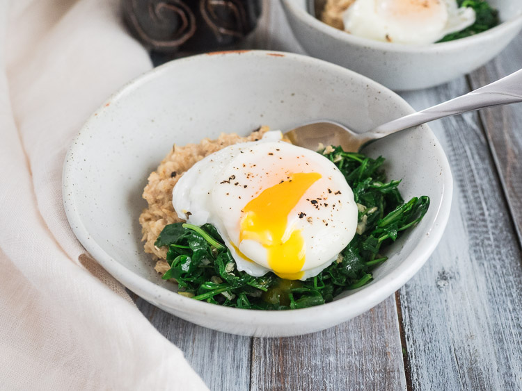 Savory Oatmeal with Wilted Arugula | A savory oatmeal breakfast with garlic wilted arugula and poached eggs is ready in less than 30 minutes. Hearty and delicious, perfect for weekdays or weekends. A great way to eat more vegetables. | SeasonedVegetable.com