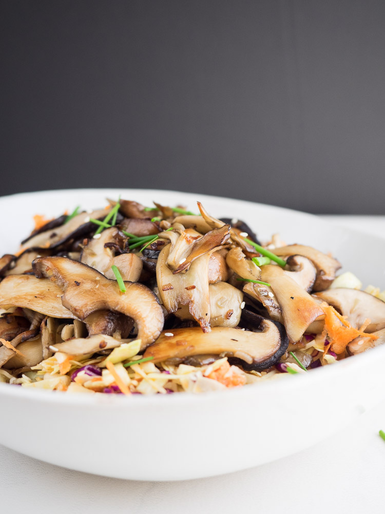 Warm Mushroom Salad | This warm mushroom salad features a bright, crunchy cabbage slaw with miso ginger dressing. Topped with earthy, caramelized mushrooms for a delicious starter. | SeasonedVegetable.com