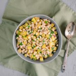 Warm Potato Salad with Corned Beans | A warm potato salad with tender, fragrant corned beans makes a lovely winter side dish. Naturally vegan and gluten free, perfect with cabbage for a vegetarian meal. | SeasonedVegetable.com #potatosalad #vegan #vegetarianrecipe #beans