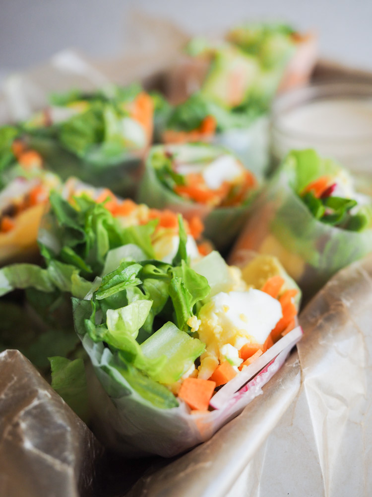 Caesar Salad Spring Rolls | These fresh caesar salad spring rolls are filled with crunchy vegetables and paired with an easy, savory miso caesar dressing. Perfect for a light lunch or appetizer! | SeasonedVegetable.com #recipe #vegetarian #springroll
