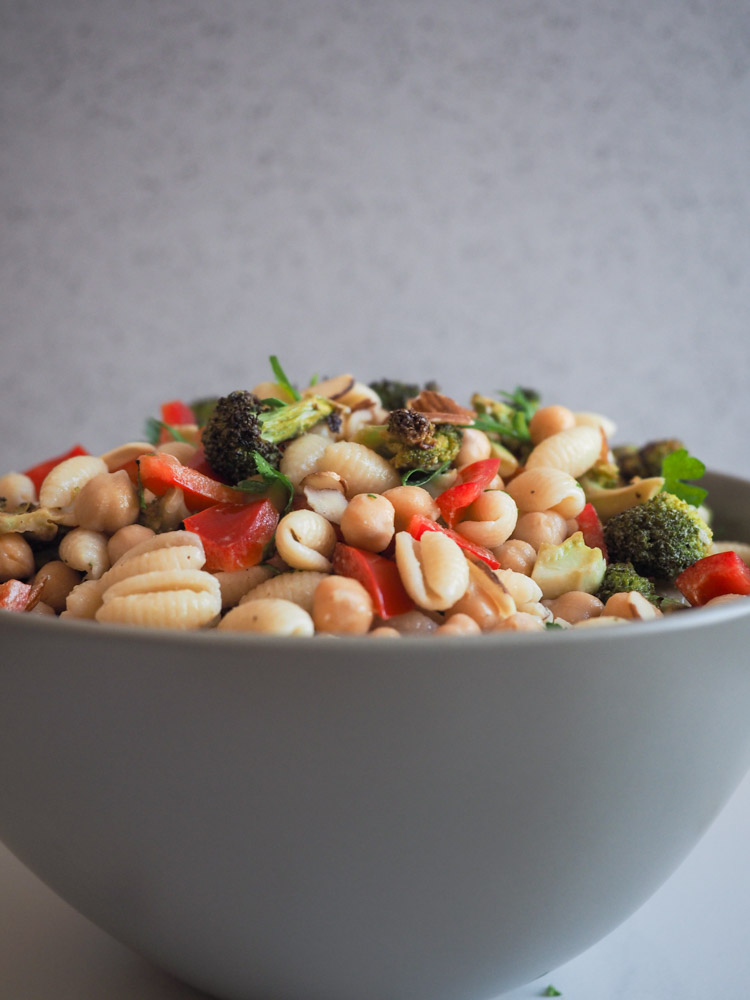 Broccoli Pasta Salad | A dairy-free broccoli pasta salad with miso caesar dressing is perfect for summer! With charred broccoli, sweet red peppers, almonds and chickpeas, it's pasta salad you can feel good about. | SeasonedVegetable.com