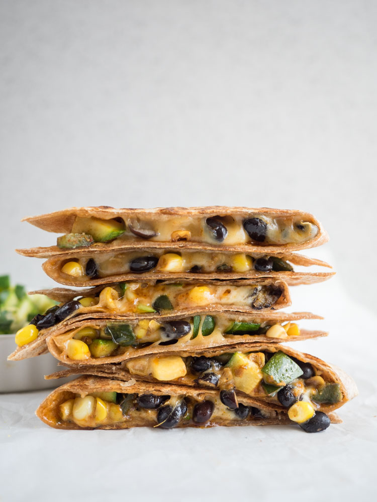 Vegetarian Fajita Quesadillas | These vegetarian fajita quesadillas are full of fresh poblano peppers, zucchini, sweet corn and black beans. Perfect for lunch or dinner! | SeasonedVegetable.com