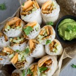Cucumber Melon Spring Rolls | These cucumber melon spring rolls are packed with lightly fried tempeh strips. With avocado cilantro dressing, it's a refreshing summer treat. | SeasonedVegetable.com