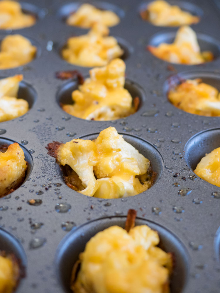 Cheddar Cauliflower Bites | A delicious appetizer, these cheddar cauliflower bites and the ultimate bite sized comfort food. Plus, easy swaps for vegan or gluten free options. | SeasonedVegetable.com #vegetarian #appetizer #cauliflowerrecipe