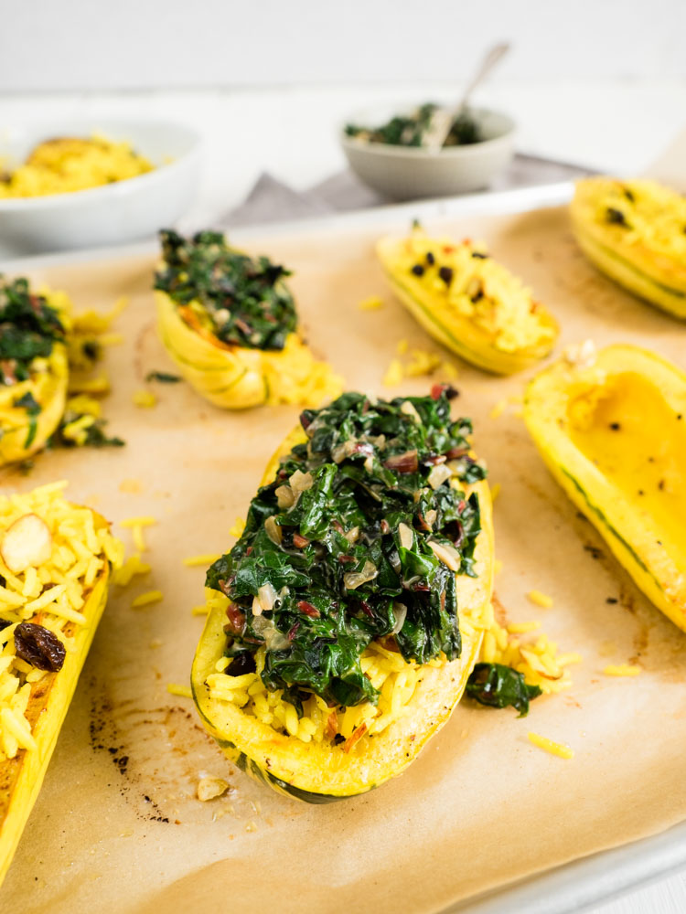 Stuffed Delicata Squash with Coconut Creamed Greens | A hearty fall recipe, this stuffed delicata squash is whole roasted and filled with savory saffron rice pilaf and creamy coconut milk braised greens. | SeasonedVegetable.com #delicatasquash #vegetarianrecipe #veganrecipe #stuffedsquash #vegan #glutenfree