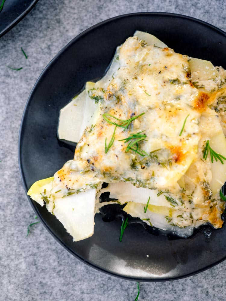 Kohlrabi Gratin with Dill and Mustard | This kohlrabi gratin is an easy casserole for any winter table. Layers of vegetables and cheese are baked with herbs and milk for a lighter, healthier twist on potatoes au gratin. | SeasonedVegetable.com #gratin #casserole #vegetarianrecipe #winter #kohlrabi