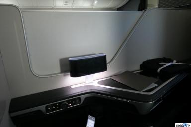 The partition between the middle seats in BA first class