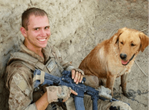 Sgt. Miller and his military working dog Thor in Afghanistan. Photo from
