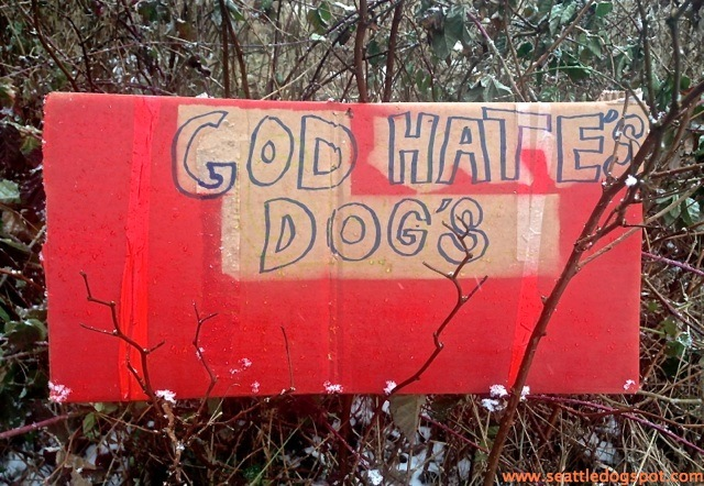 """One of the signs OAS supporters put up across the street from the """"animal activists"""" protesting outside the OAS warehouse. Photo from Seattle DogSpot"""