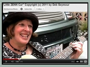"Image of Deb Seymour singing ""Little ZENN Car"""