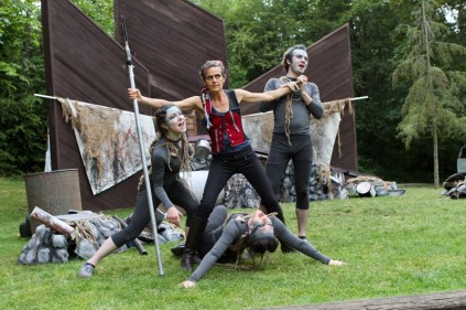 "Amy Thone (center) surrounded by the Ariels (l-r) Olivia Hartshorn, Tonya Andrews, Scott Ward Abernethy in Seattle Shakespeare Company's 2013 Wooden O production of ""The Tempest."""