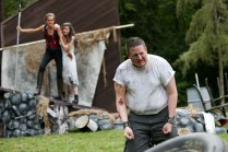 """(L-R) Amy Thone as Prospero, Anastasia Higham as Miranda, and Brian D. Simmons as Caliban in Seattle Shakespeare Company's 2013 Wooden O production of """"The Tempest."""""""