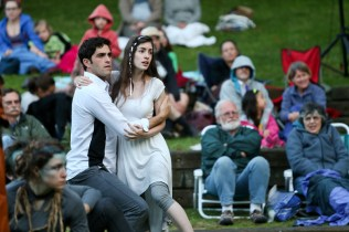"Jonathan Crimeni as Ferdinand and Anastasia Higham as Miranda in Seattle Shakespeare Company's 2013 Wooden O production of ""The Tempest."""