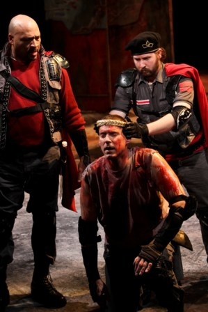 "Lance McQueen as Cominus, David Drummond as Coriolanus, and Tom Dewey as Titus Lartius in Seattle Shakespeare Company's 2012 production of ""Coriolanus."" Photo by John Ulman."
