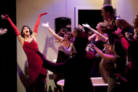 Allison Standley as Kate, Troy Wageman as Burrs   and the cast of The Wild Party.  Photo by Ken Holmes.