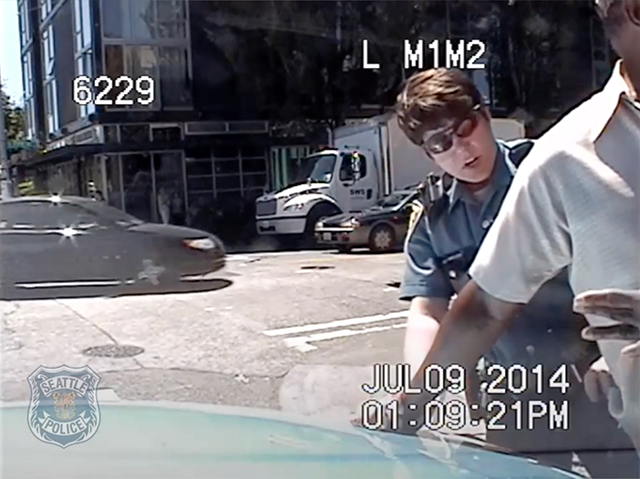 Seattle's Dumbest Cop, caught in the act. Seattle Police Department