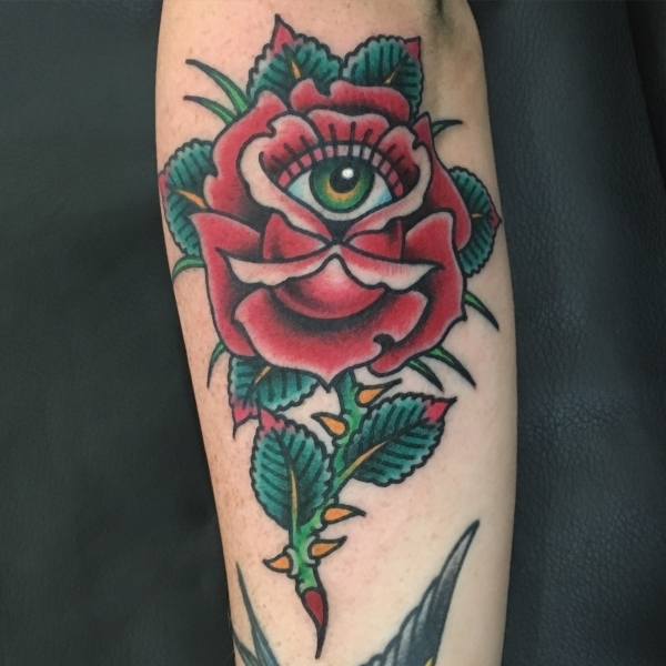 rose and eye tattoo
