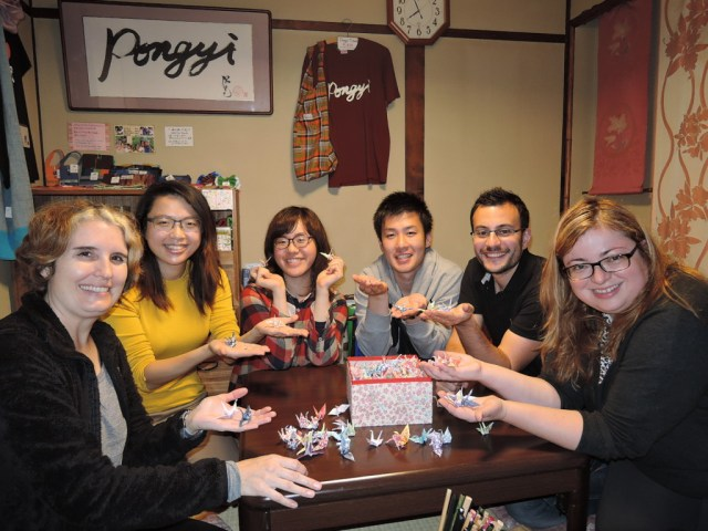 Creating origami cranes for a peace project at Pongyi Guesthouse, Kanazawa