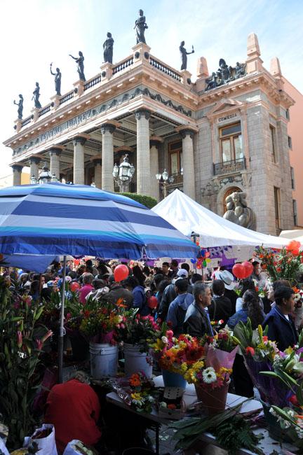 Selling flowers on Día de las Flores, Guanajuato, Mexico