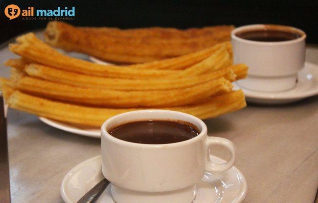 Enjoying porras and chocolate. Photo courtesy of AIL Madrid.