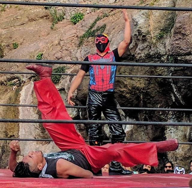 Lucha libre. This was a crazy experience. The luchadores hit each other with chairs and fluorescent light bulbs. There was broken glass everywhere.