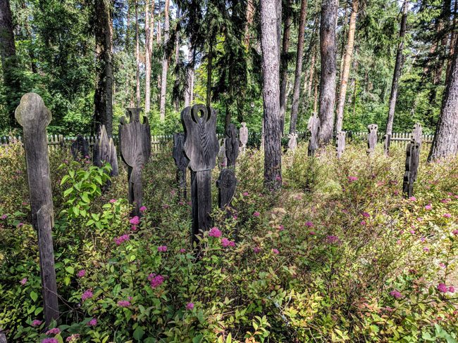 Pagan burial markers called krikštai in Nida's old graveyard. Lithuania was the last European country to be Christianized, and many pagan traditions persist.