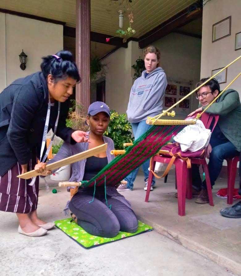 Learning to do backstrap weaving at SISAI - Spanish immersion Guatemala
