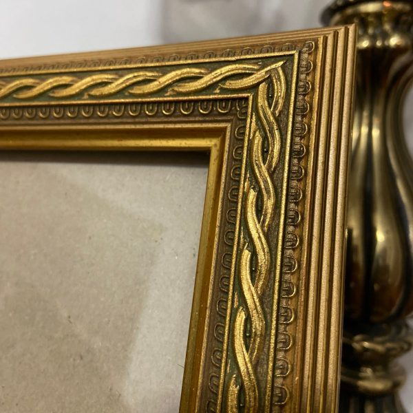 Close-up view of Ornate Gold Frame