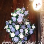 Wedding Cupcakes in tower stand with purple n white flowers cupcakes from Second Slices® cake shop n bakery in Edmonton AB