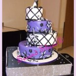 white and purple 4 tiers round wedding cake with black accents from Second Slices® cake shop n bakery in Edmonton AB