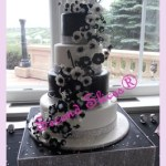 black and white round 4 tiers wedding cake with white n black flowers from Second Slices® cake shop n bakery in Edmonton AB