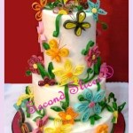 colorful flowers whimsical white round wedding cake from Second Slices® cakeshop cakemaker bakery in Edmonton AB