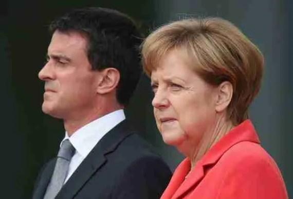 Manuel Valls y Angel Merkel