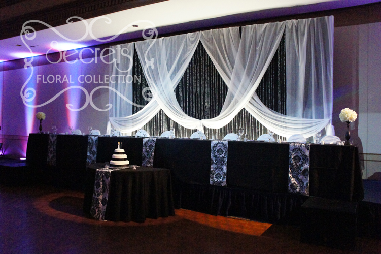 black and white crystal rain backdrop and damask tables