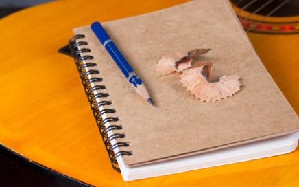 guitar, pencil and notepad