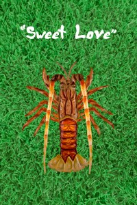 "Poster. Center is a lobster on a green lawn of grass. Text: ""Sweet Love"""