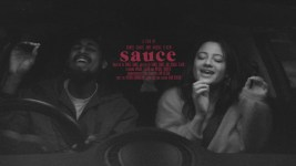 black and white image of a man and woman laughing in a car text reads a film by Daniel Daniel and Avigail Tlalim