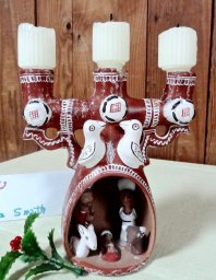 The Holy Family in a candelabra was crafted in Peru. It is owned by Barbara Smith.