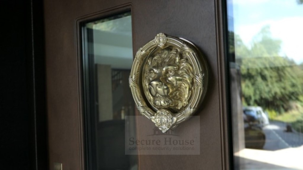 Luxurious ironmongery from Secure House - antique brass finish lion's head knocker