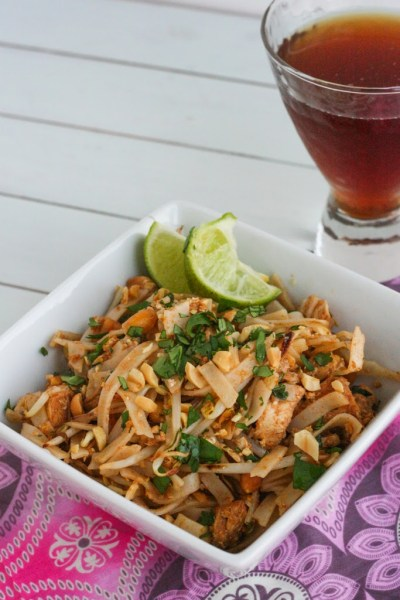 Bowl of super easy pad thai noodles with cilantro and peanuts with a lime
