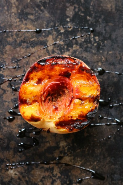 Easy Grilled Peach with Balsamic Glaze drizzle on pan